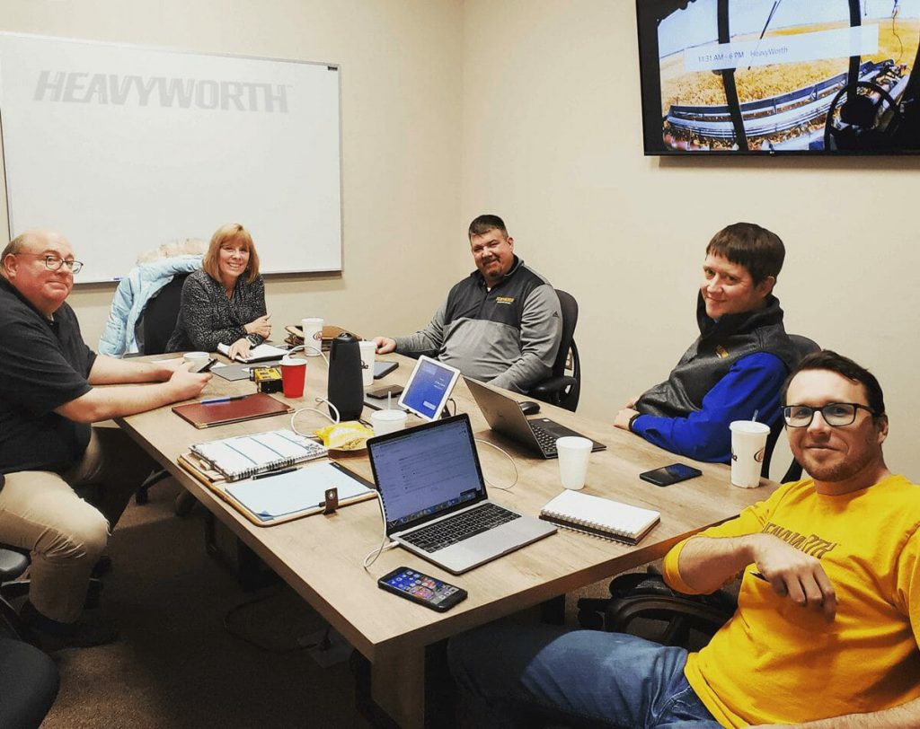 The HeavyWorth team at a conference table